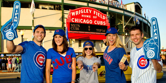 Cubs fans posing outside Wrigley Field